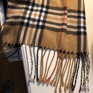 Never worn Paid Scarf.  Blend of wool & polyester